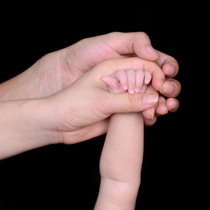 Hände einer Familie