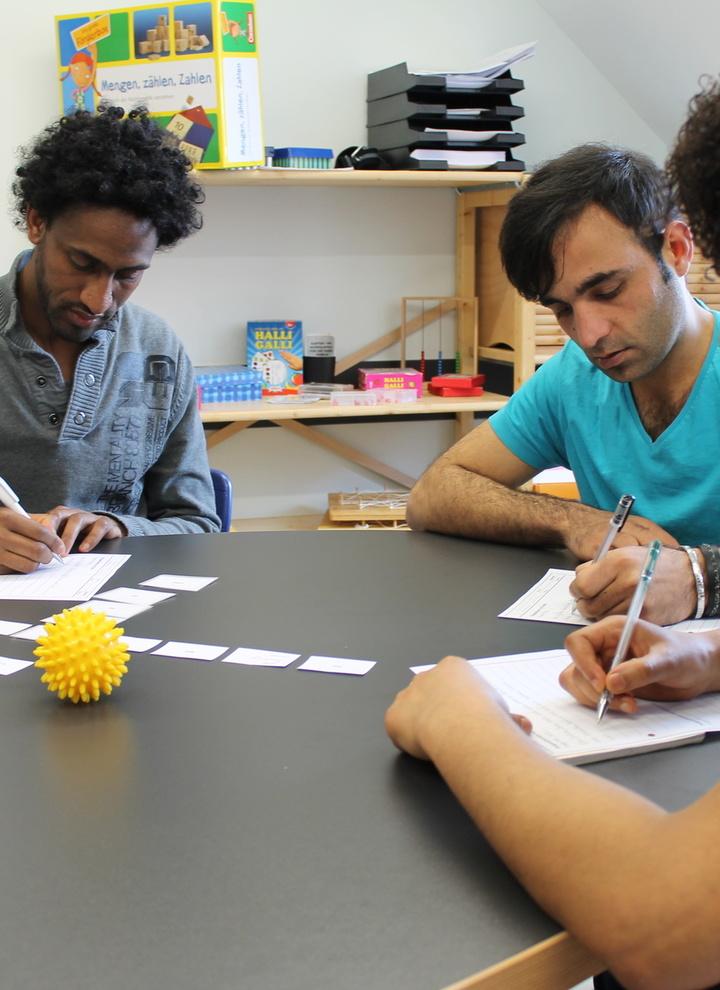 Flüchtlinge beim Sprachkurs